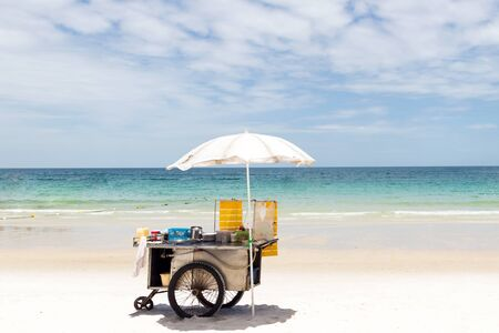 Cart selling roti snack on the beautiful beach in sunny day; popular street snack in Thailand