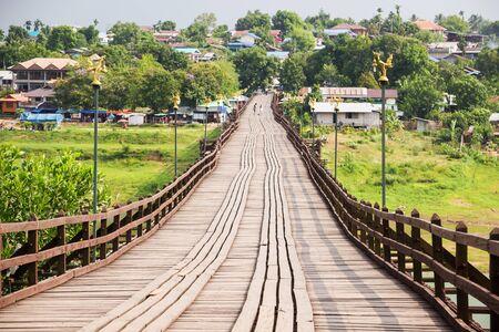 The longest wooden bridge of Thailand (Mon Bridge) across the Songkhalia river in Sangkhlaburi, Kanchanaburi, Thailand.