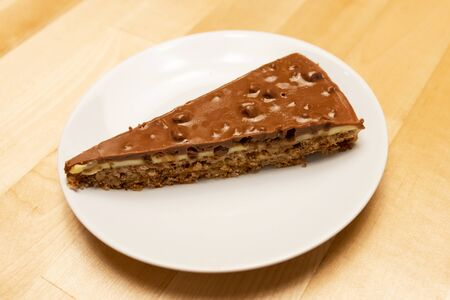 Delicious caramel and chocolate layered cracker toffee on table.