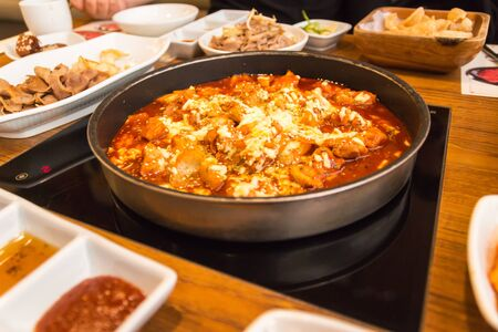 Gopchang bokkeum is korea traditional tripe stir fry with cheese.