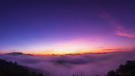 The beautiful early morning sky with twilight and waves of fog of Baan Ja Bo village viewpoint Pang Mapha, Mae Hong Son, Northern Thailand. Panorama view Stok Fotoğraf
