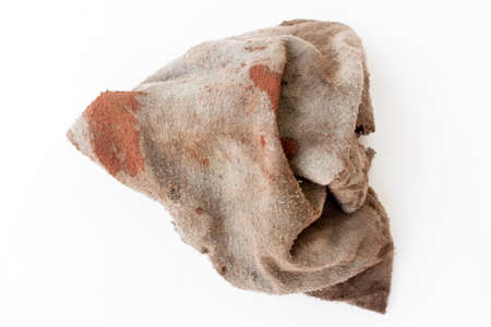 Dirty rag isolated on white background. Foto de archivo