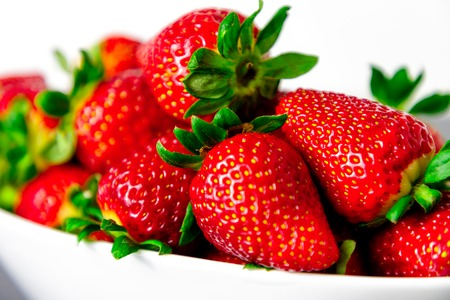 strawberry on white bowl with white background.