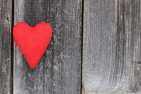 Valentine day, red handmade heart on grey wood background.Valentines Day card. Фото со стока