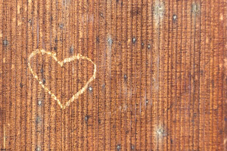 Valentines day carved heart on old wood. Holidays card with copy space.