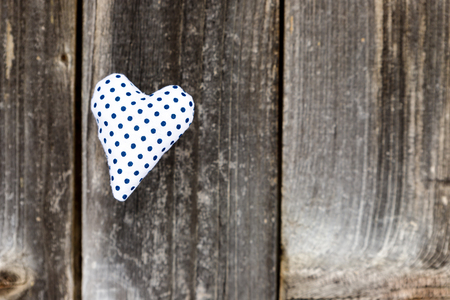 Valentine day, blue dotted handmade heart on grey wood background.Valentines Day card.