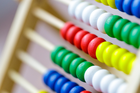Colorful vintage style wooden abacus. For Learning Basic Mathematics Calculator - Close up. Фото со стока