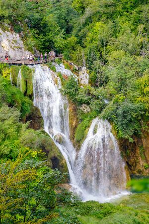 Beautiful view of the most famous waterfalls in the sunshine in Plitvice National Park, Croatia. Фото со стока