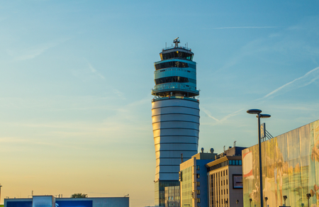Airport traffic control tower at vienna International Airport on a clear sunny day. Austria.