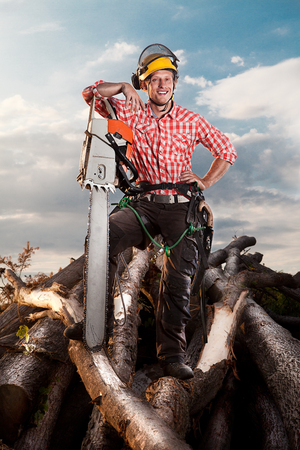 smiling lumberjack with chainsaw Stock Photo