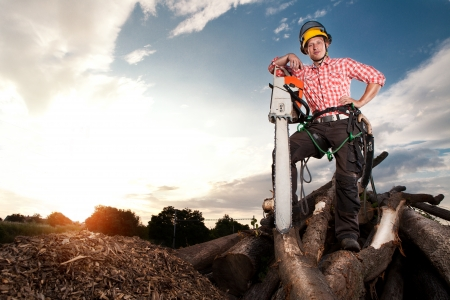 smiling lumberjack with chainsaw photo
