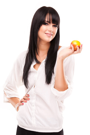 beautiful brunette woman with orange on white background Stock Photo