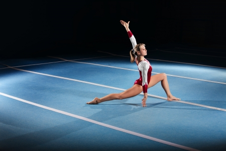 female gymnast: portrait of young gymnasts competing in the stadium