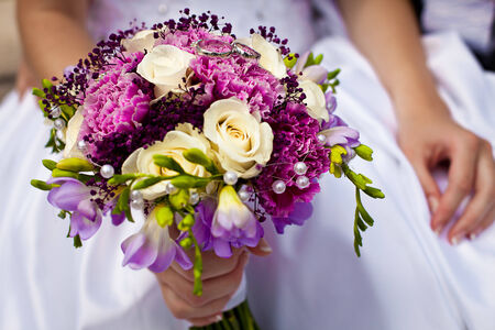 Beautiful colorful wedding bouquet with bride and groom Stock Photo