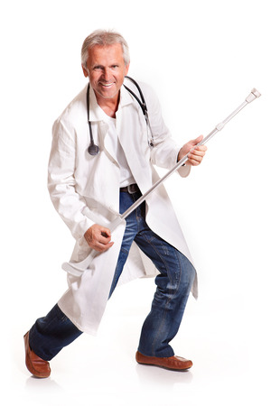 dancing mad doctor with crutches on white background