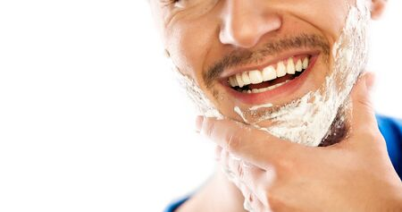 smiling man with shaving foam
