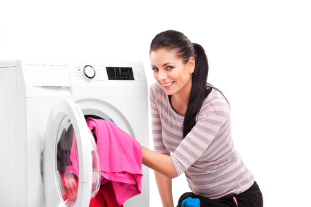 Studio photo of woman launderers clothes Stock Photo