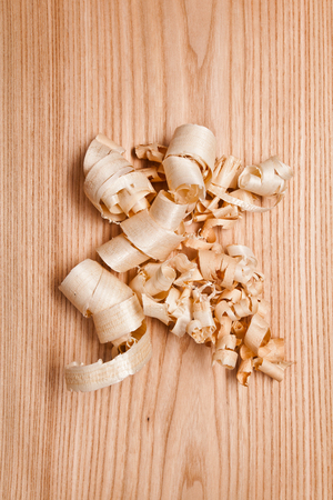 wood shavings: Woodchips (shavings) on wooden surface Stock Photo