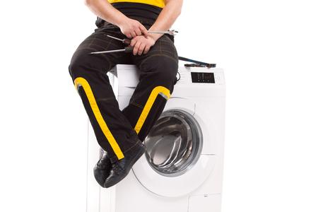 studio photo of washing machine repairman photo