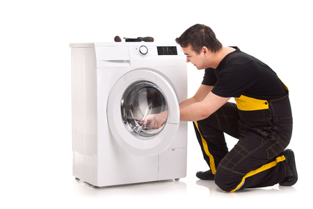 studio photo of washing machine repairman Stock Photo - 23764785
