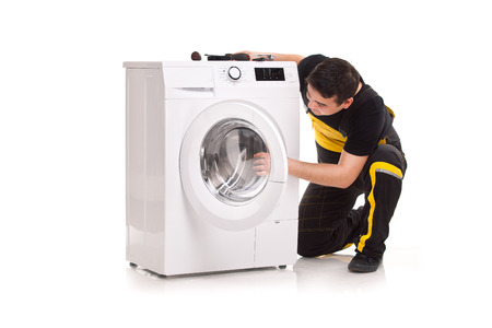 studio photo of washing machine repairman Stock Photo - 23764807