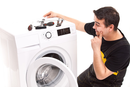 studio photo of washing machine repairman Stock Photo - 23764808
