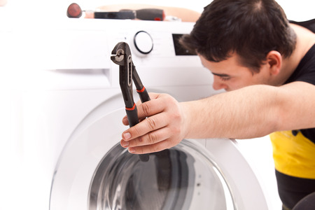 studio photo of washing machine repairman Stock Photo - 23764810