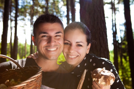 Couple picking mushrooms in the forest Stock Photo - 23764961