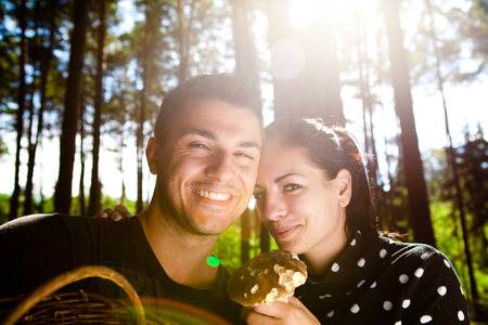 Couple picking mushrooms in the forest Stock Photo - 23764964