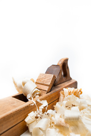 wood shavings: planer with wooden chips, wood shavings isolated on white background