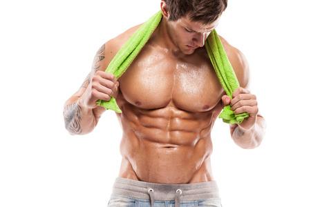 sin camisa: Fuerte Hombre Atlético Modelo Fitness Torso mostrando seis ABS del paquete que sostienen una toalla