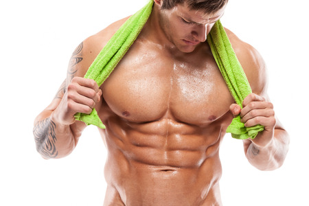 6 pack: Strong Athletic Man Fitness Model Torso showing six pack abs  holding towel