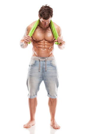 Strong Athletic Man Fitness Model Torso showing six pack abs  holding towel