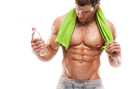 Strong Athletic Man Fitness Model Torso showing six pack abs  holding bottle of water and towel Standard-Bild
