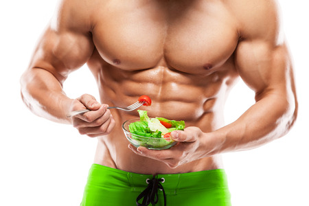muscular: Shaped and healthy body man holding a fresh salad bowl