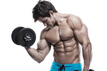 Muscular bodybuilder guy doing exercises with dumbbells isolated over white background photo