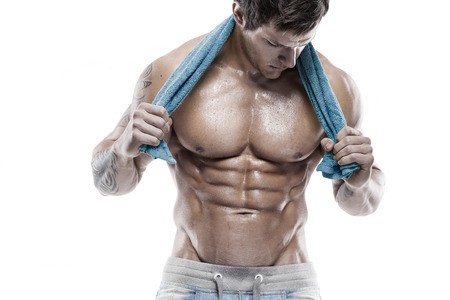 six pack: Strong Athletic Man Fitness Model Torso showing six pack abs. holding towel Stock Photo