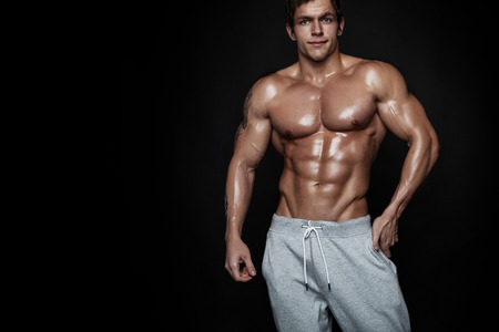 six pack abs: Strong Athletic Man Fitness Model Torso showing muscles Stock Photo
