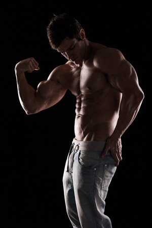 6 pack: Strong Athletic Man Fitness Model Torso showing muscles isolated on black background