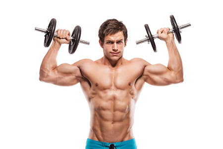 sexy muscular man: Muscular bodybuilder guy doing exercises with dumbbells over white background