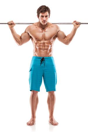 male bodybuilder: Muscular bodybuilder guy doing exercises with dumbbells over white background