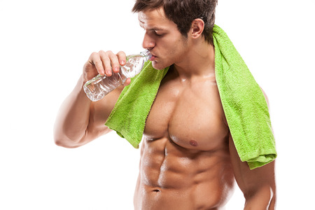 Strong Athletic Man Fitness Model drinking fresh water over white background