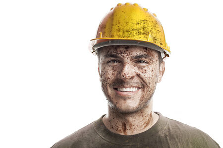 face work: Young dirty Worker Man With Hard Hat helmet isolated on White Background