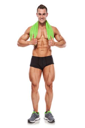 Sterke atletische mens Fitness Model Torso toont zes pack abs. met een handdoek geïsoleerd over witte achtergrond Stockfoto