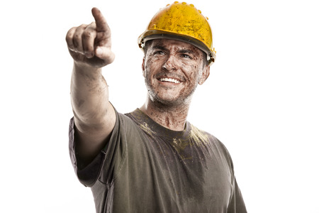 pointing young dirty Worker Man With Hard Hat helmet isolated on White Background