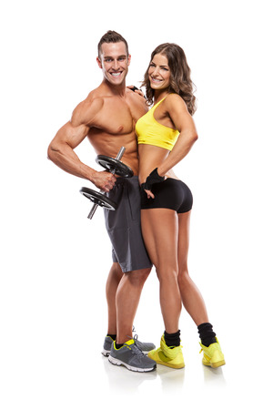 beautiful fitness young sporty couple with dumbbell isolated over white background
