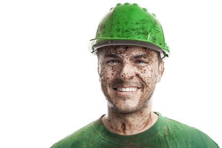 mire: Young dirty Worker Man With Hard Hat helmet isolated on White Background