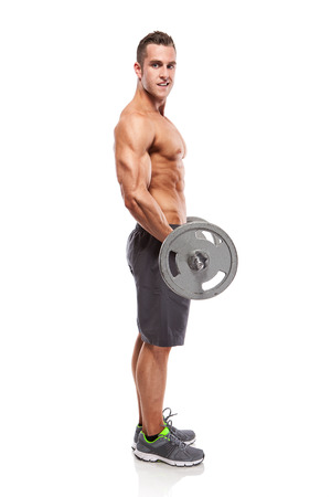 side: Muscular bodybuilder guy doing exercises with big dumbbell over white background