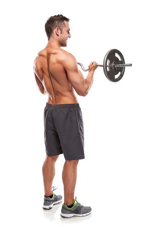 hombres sin camisa: Tipo culturista muscular haciendo ejercicios con pesa de gimnasia grande sobre fondo blanco