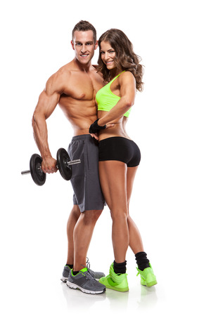 culo: Fitness hermosa joven pareja deportiva con mancuerna aislados sobre fondo blanco Foto de archivo